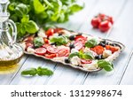 caprese salad with mozzarella... | Shutterstock . vector #1312998674