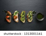fresh tasty bruschettas on dark ... | Shutterstock . vector #1313001161