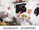 happy woman chef serving fresh... | Shutterstock . vector #1313049281