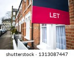 a street of red brick houses... | Shutterstock . vector #1313087447