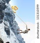 businesswoman climbing mountain ... | Shutterstock . vector #131310599