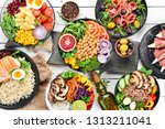 buddha bowl on a white wooden... | Shutterstock . vector #1313211041