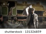 Small photo of Emigrant man with the suitcases