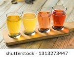 refreshing hard cider flight of ... | Shutterstock . vector #1313273447