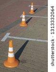 orange traffic cones standing... | Shutterstock . vector #1313332064