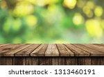 empty wooden table background | Shutterstock . vector #1313460191