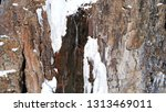 freezing waterfall. big icicles ... | Shutterstock . vector #1313469011