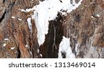 freezing waterfall. big icicles ... | Shutterstock . vector #1313469014
