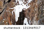 freezing waterfall. big icicles ... | Shutterstock . vector #1313469017