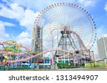 Small photo of Yokohama, Japan - September 12th, 2018: Giant ferris wheel Cosmo Clock 21 at the Cosmo World amusement park in Yokohama, Japan.