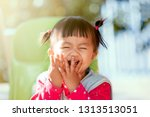 Stock photo cute asian baby girl laughing and playing peekaboo or hide and seek with fun 1313513051