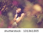 bride and groom looking at each ... | Shutterstock . vector #131361305