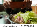 woman take a picture on hot pot ...   Shutterstock . vector #1313758124
