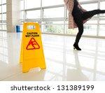 woman slips next to wet floor... | Shutterstock . vector #131389199