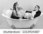 bubble bath day. couple in bath ... | Shutterstock . vector #1313924387