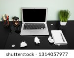 workplace with laptop on black... | Shutterstock . vector #1314057977