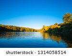 picturesque forest and the river | Shutterstock . vector #1314058514