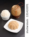 Different kinds of Thai style rices prepared including white jasmine and brown rice. - stock photo