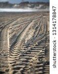Tire Tracks On A Sandy Beach...