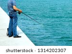 the man on the dock with a... | Shutterstock . vector #1314202307