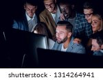 business team looks closely at... | Shutterstock . vector #1314264941