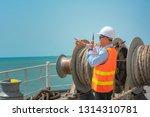 ship crew under safe working in ... | Shutterstock . vector #1314310781
