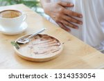 woman having stomach pain or... | Shutterstock . vector #1314353054