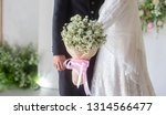 lovely bride holding a bouquet... | Shutterstock . vector #1314566477
