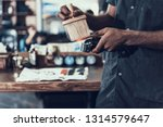 cropped photo of calm master... | Shutterstock . vector #1314579647