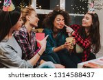 Small photo of What funny clownish nose. Outgoing women having fun during birthday celebration