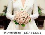 bride holding her bouquet ...   Shutterstock . vector #1314613331