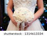 bride holding her bouquet ...   Shutterstock . vector #1314613334