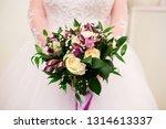 bride holding her bouquet ...   Shutterstock . vector #1314613337