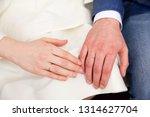 wedding couple hands with...   Shutterstock . vector #1314627704