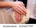 wedding couple hands with...   Shutterstock . vector #1314627707