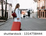 young woman traveler with a... | Shutterstock . vector #1314758444