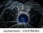 a person staying in the tunnel... | Shutterstock . vector #1314786581