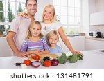 smiling posing family cutting...