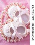 overhead of white baby booties...   Shutterstock . vector #131486765