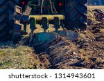 tractor with plough  plow ... | Shutterstock . vector #1314943601
