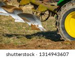 tractor with plough  plow ... | Shutterstock . vector #1314943607