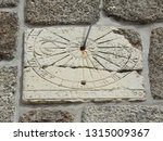 Vertical Stone Sundial On The...