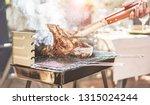 male chef grill t bone steak at ...   Shutterstock . vector #1315024244