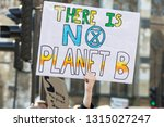 Protestors holding climate...