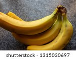 yellow bananas on table | Shutterstock . vector #1315030697