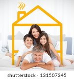 smiling family portrait in bed... | Shutterstock . vector #131507345