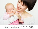 young mother holding her baby | Shutterstock . vector #13151500
