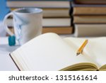 journal in library with mug | Shutterstock . vector #1315161614