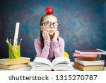 thoughtful elementary school...   Shutterstock . vector #1315270787