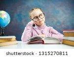 beautiful little schoolgirl... | Shutterstock . vector #1315270811